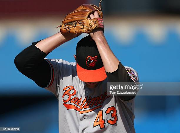 Jim Johnson of the Baltimore Orioles delivers a pitch during MLB game action against the Toronto Blue Jays on September 3 2012 at Rogers Centre in...