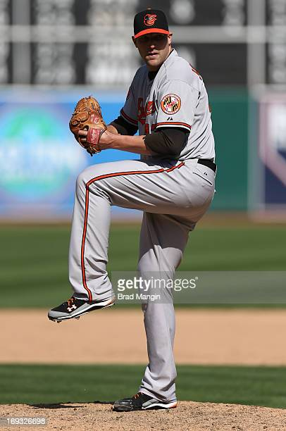 Jim Johnson of the Baltimore Orioles pitches during the game against the Oakland Athletics on April 27 2013 at The Oco Coliseum in Oakland California