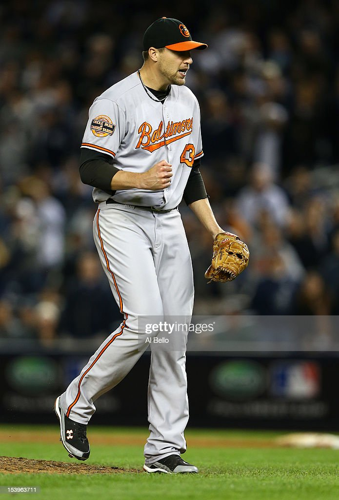 Jim Johnson #43 of the Baltimore Orioles reacts after the defeating the New York Yankees in thirteen innings in Game Four of the American League Division Series at Yankee Stadium on October 11, 2012 in the Bronx borough of New York City.