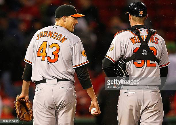 Jim Johnson of the Baltimore Orioles smiles at Matt Wieters after defeating the Boston Red Sox 32 at Fenway Park on April 11 2013 in Boston...