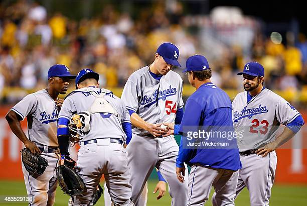 Jim Johnson of the Los Angeles Dodgers is pulled from the game in the 7th inning by manager Don Mattingly against the Pittsburgh Pirates during the...