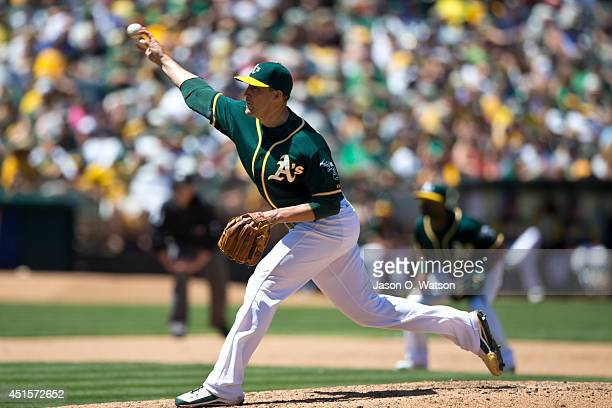 Jim Johnson of the Oakland Athletics pitches against the Boston Red Sox during the sixth inning at Oco Coliseum on June 22 2014 in Oakland California...