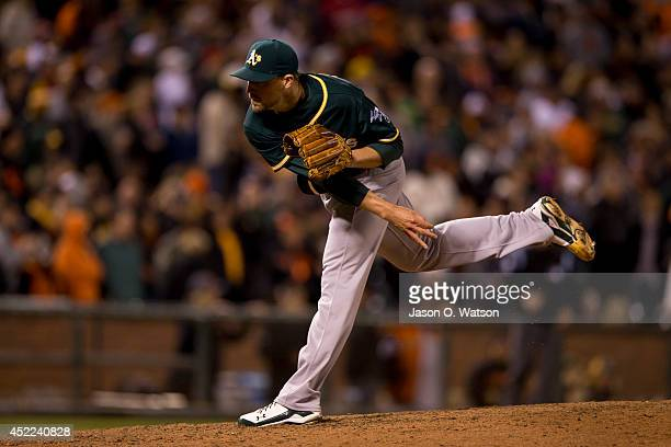 Jim Johnson of the Oakland Athletics pitches against the San Francisco Giants during the seventh inning at ATT Park on July 9 2014 in San Francisco...