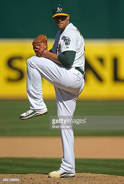 Jim Johnson of the Oakland Athletics pitches against the Seattle Mariners during the game at Oco Coliseum on Sunday April 6 2014 in Oakland California