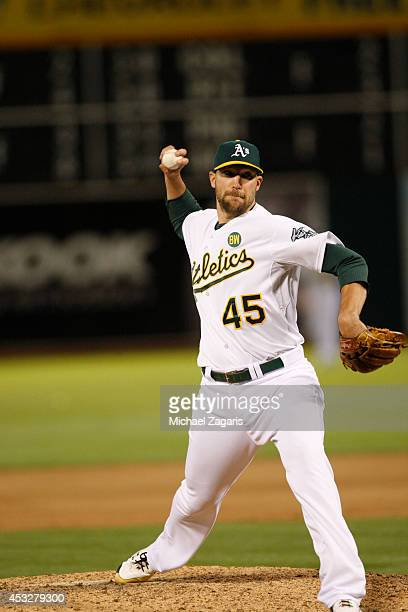 Jim Johnson of the Oakland Athletics pitches during the game against the Baltimore Orioles at Oco Coliseum on July 19 2014 in Oakland California The...