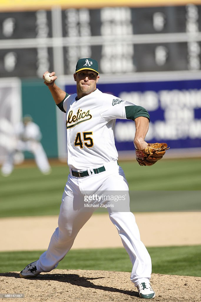 Jim Johnson #45 of the Oakland Athletics pitches during the game against the Seattle Mariners at O.co Coliseum on April 6, 2014 in Oakland, California. The Athletics defeated the Mariners 6-3.