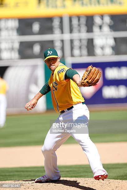 Jim Johnson of the Oakland Athletics pitches during the game against the Washington Nationals at Oco Coliseum on May 11 2014 in Oakland California...