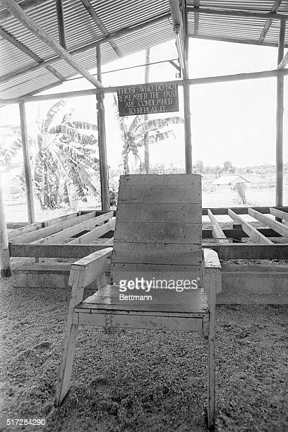 Jim Jone's lawn chair 'throne' stands in front of the stage in the main pavilion its floor boards torn up because 'they were soaked with blood' in...