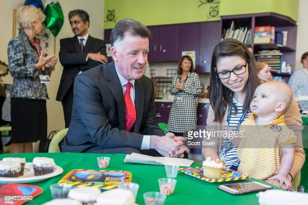 Jim Judge Chairman President and CEO of Eversource left decorates cupcakes with Catherine and mom at Boston Children's Hospital on June 7 2017 in...