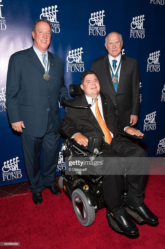 Jim Kelly, <a gi-track='captionPersonalityLinkClicked' href=/galleries/search?phrase=Marc+Buoniconti&family=editorial&specificpeople=736871 ng-click='$event.stopPropagation()'>Marc Buoniconti</a>, and <a gi-track='captionPersonalityLinkClicked' href=/galleries/search?phrase=Terry+Bradshaw&family=editorial&specificpeople=204175 ng-click='$event.stopPropagation()'>Terry Bradshaw</a> attend the 28th annual Great Sports Legends Dinner to Benefit The Buoniconti Fund To Cure Paralysis at The Waldorf=Astoria on September 30, 2013 in New York City.