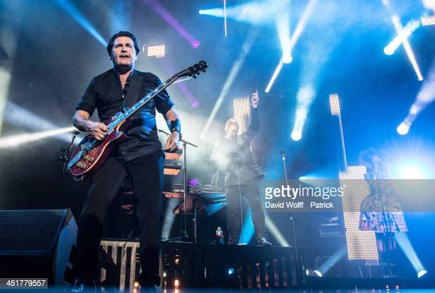 Jim Kerr and Charlie Burchill from Simple Minds perform at Le Zenith on November 24 2013 in Paris France