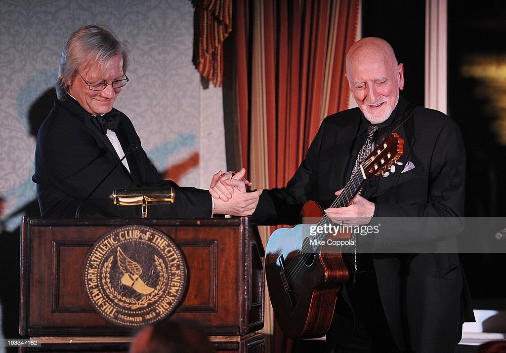 Jim Kerr (L) and <a gi-track='captionPersonalityLinkClicked' href=/galleries/search?phrase=Dominic+Chianese&family=editorial&specificpeople=175942 ng-click='$event.stopPropagation()'>Dominic Chianese</a> shake hands before Dominic's performance at the Table 4 Writers Foundation 1st Annual Awards Gala on March 7, 2013 in New York City.