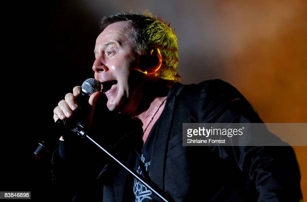 Jim Kerr of Simple Minds performs on stage at the Manchester Evening News Arena on November 27 2008 in Manchester England