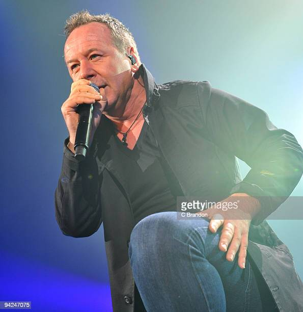 Jim Kerr of Simple Minds performs on stage at Wembley Arena on December 7 2009 in London England