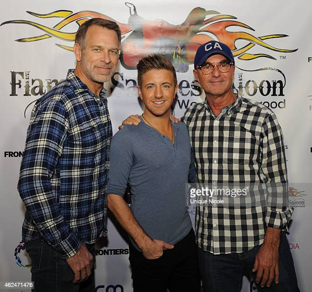 Jim Key Billy Gilman and guest attend Flaming Saddles Saloon opening on January 28 2015 in West Hollywood California