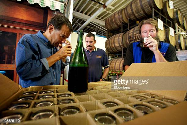 Jim Koch founder of Boston Beer Co left and Oceanside Ale Works founders Scott Thomas center and Mark Purciel right take in the bouquet of a special...