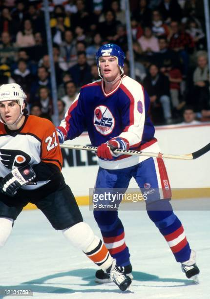 Jim Kyte of the Winnipeg Jets defends against Rick Tocchet of the Philadelphia Flyers during their game on January 30 1988 at the Spectrum in...