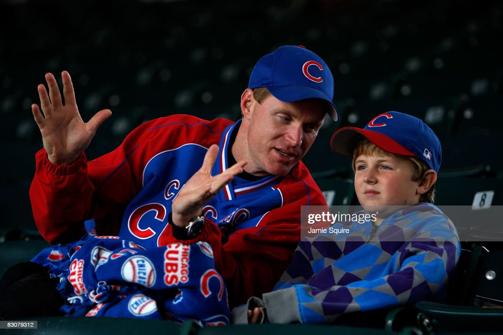 Jim Labery and his son James watch batting practice from the stands prior to the Chicago Cubs playing against the Los Angeles Dodgers in Game One of the NLDS during the 2008 MLB Playoffs at Wrigley Field on October 1, 2008 in Chicago, Illinois.