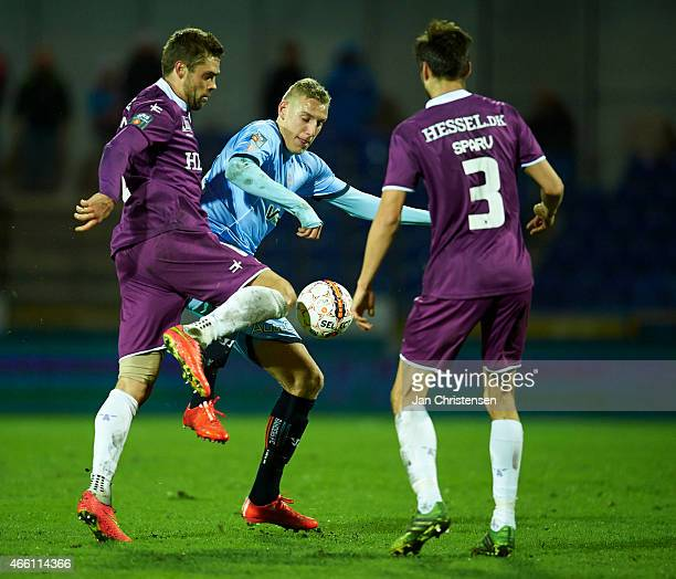 Jim Larsen of FC Midtjylland Nicolai BrockMadsen of Randers FC and Tim Sparv of FC Midtjylland compete for the ball during the Danish Alka Superliga...