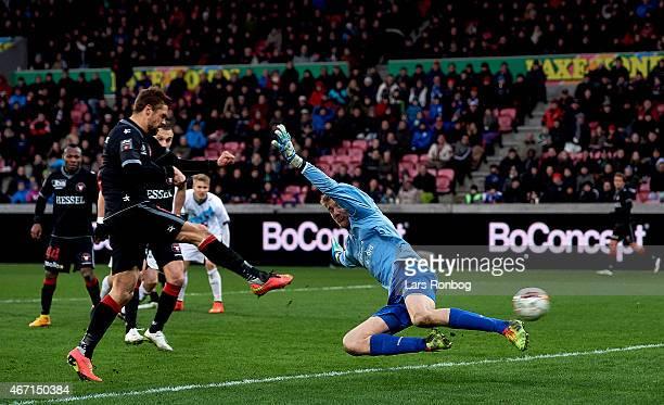 Jim Larsen of FC Midtjylland scores the 20 goal against goalkeeper Jesper Rask of Hobro IK during the Danish Alka Superliga match between FC...