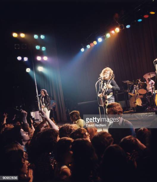 Jim Lea and Noddy Holder of Slade perform on stage in 1975