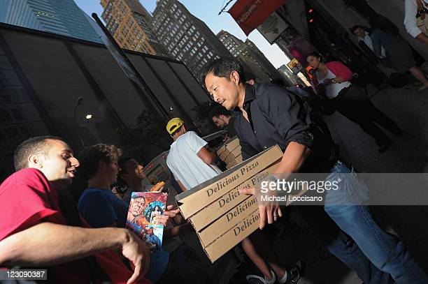 Jim Lee artist and copublisher of DC Comics with fans at Midnight Madness event celebrating the release of New No 1 issue of 'Justice League' at Mid...