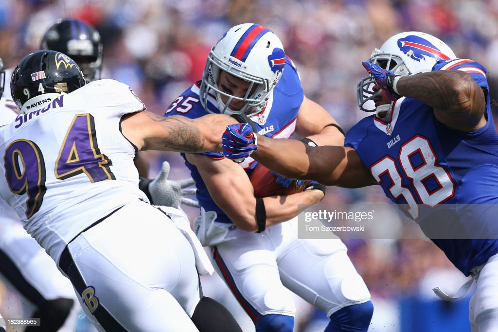 <a gi-track='captionPersonalityLinkClicked' href=/galleries/search?phrase=Jim+Leonhard&family=editorial&specificpeople=240112 ng-click='$event.stopPropagation()'>Jim Leonhard</a> #35 of the Buffalo Bills is tackled as he returns a punt during NFL game action by John Simon #94 of the Baltimore Ravens at Ralph Wilson Stadium on September 29, 2013 in Orchard Park, New York.