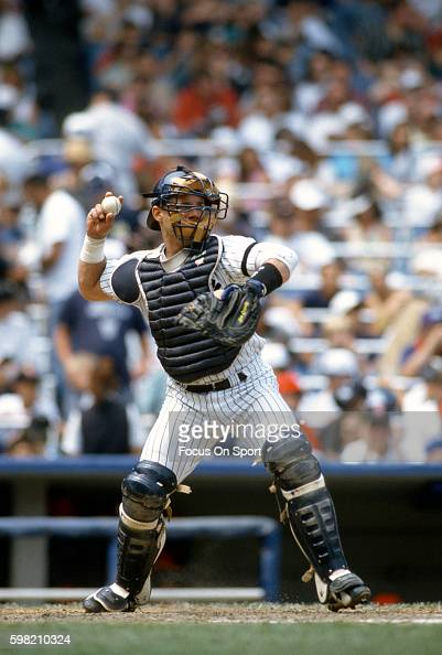 Jim Leyritz of the New York Yankees in looks to throw down to second base during an Major League Baseball game circa 1996 at Yankee Stadium in the...