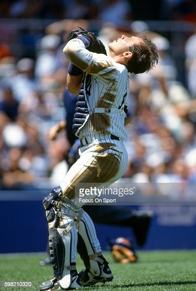 Jim Leyritz of the New York Yankees in tracks a foul popup during an Major League Baseball game circa 1996 at Yankee Stadium in the Bronx borough of...