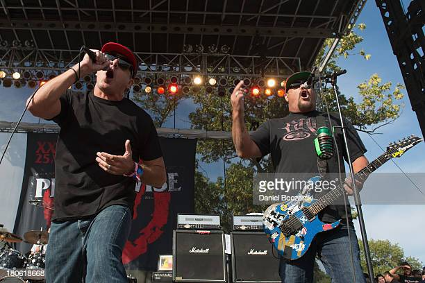 Jim Lindberg and Fletcher Dragge of Pennywise perform on stage on Day 2 of Riot Fest and Carnival 2013 at Humboldt Park on September 14 2013 in...