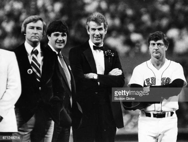 Jim Lonborg left and Carl Yastrzemski are honored along with the rest of the Red Sox Impossible Dream team of 1967 during a Red Sox game at Fenway...