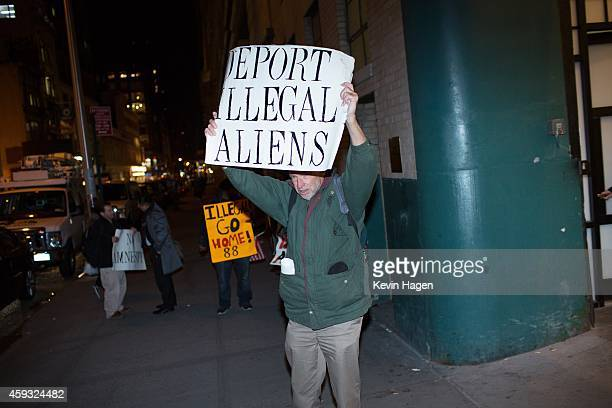 Jim MacDonald an activist from the organization New Yorkers for Immigration Control and Enforcement holds a protest sign outside the offices of 32BJ...