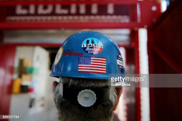 Jim Mahoney the material hoist operator poses for a photo at One Dalton Street in Boston Aug 17 2017 The 65story building will become the Four...