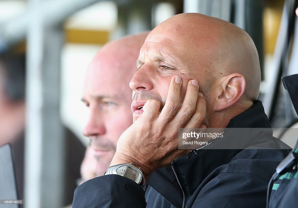 Jim Mallinder, the Northampton director of rugby looks on during the pre season friendly match between Northampton Saints and Moseley at Franklin's Gardens on August 23, 2014 in Northampton, England.