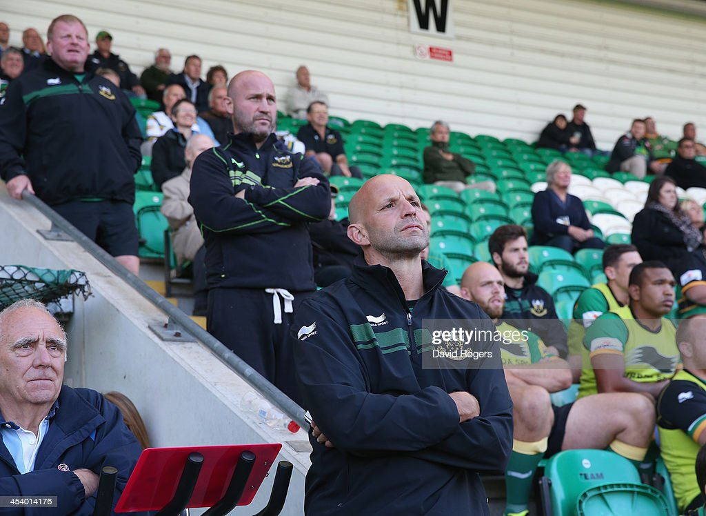 Jim Mallinder,(R) the Northampton director of rugby looks on with his coaches Alex King and Dorian West (L) during the pre season friendly match between Northampton Saints and Moseley at Franklin's Gardens on August 23, 2014 in Northampton, England.