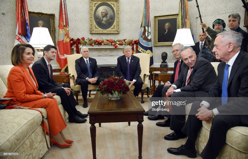 Jim Mattis, U.S. Secretary of Defense, from right, speaks as Senate Minority Leader Chuck Schumer, a Democrat from New York, Senate Majority Leader Mitch McConnell, a Republican from Kentucky, U.S. President Donald Trump, U.S. Vice President Mike Pence, U.S. House Speaker Paul Ryan, a Republican from Wisconsin, and House Minority Leader Nancy Pelosi, a Democrat from California, listen during a meeting in the Oval Office of the White House in Washington, D.C., U.S., on Thursday, Dec. 7, 2017. Trump is meeting with the congressional leaders from both parties to negotiate on a long-term budget deal as Congress prepares to pass a stopgap spending measure to avoid a U.S. government shutdown Saturday. Photographer: Olivier Douliery/Pool via Bloomberg