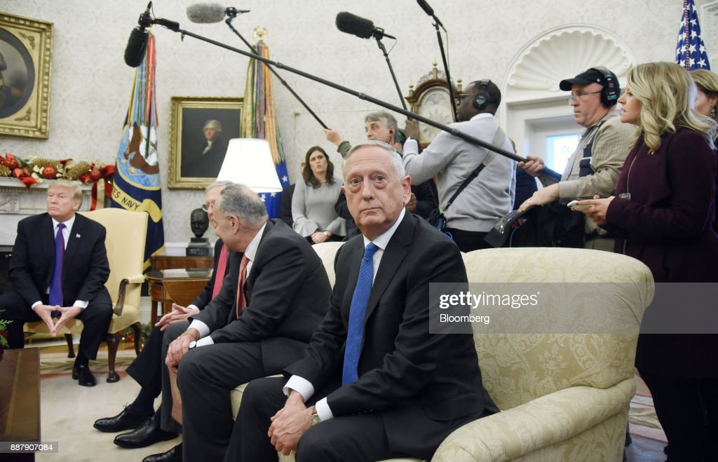 Jim Mattis, U.S. Secretary of Defense, right, sits during a meeting with U.S. President Donald Trump, left, and congressional leadership in the Oval Office of the White House in Washington, D.C., U.S., on Thursday, Dec. 7, 2017. Trump is meeting with the congressional leaders from both parties to negotiate on a long-term budget deal as Congress prepares to pass a stopgap spending measure to avoid a U.S. government shutdown Saturday. Photographer: Olivier Douliery/Pool via Bloomberg