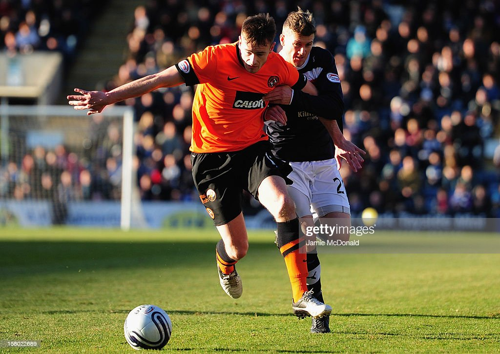 Jim McAlister of Dundee battles with Brian McLean of Dundee United during the Clydesdale Bank Premier League match between Dundee and Dundee United at Dens Park Stadium on December 9, 2012 in Dundee, Scotland.