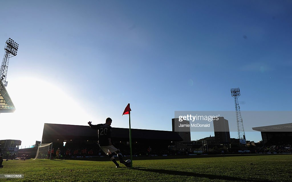 Jim McAlister of Dundee takes a corner during the Clydesdale Bank Premier League match between Dundee and Dundee United at Dens Park Stadium on December 9, 2012 in Dundee, Scotland.