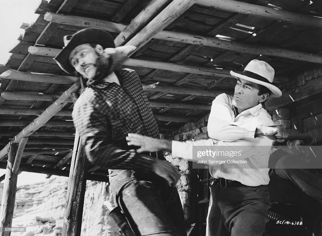 Jim McKay (<a gi-track='captionPersonalityLinkClicked' href=/galleries/search?phrase=Gregory+Peck&family=editorial&specificpeople=69992 ng-click='$event.stopPropagation()'>Gregory Peck</a>, right) punches Buck Hannassey (<a gi-track='captionPersonalityLinkClicked' href=/galleries/search?phrase=Chuck+Connors&family=editorial&specificpeople=93230 ng-click='$event.stopPropagation()'>Chuck Connors</a>) in a scene from the 1958 film The Big Country.