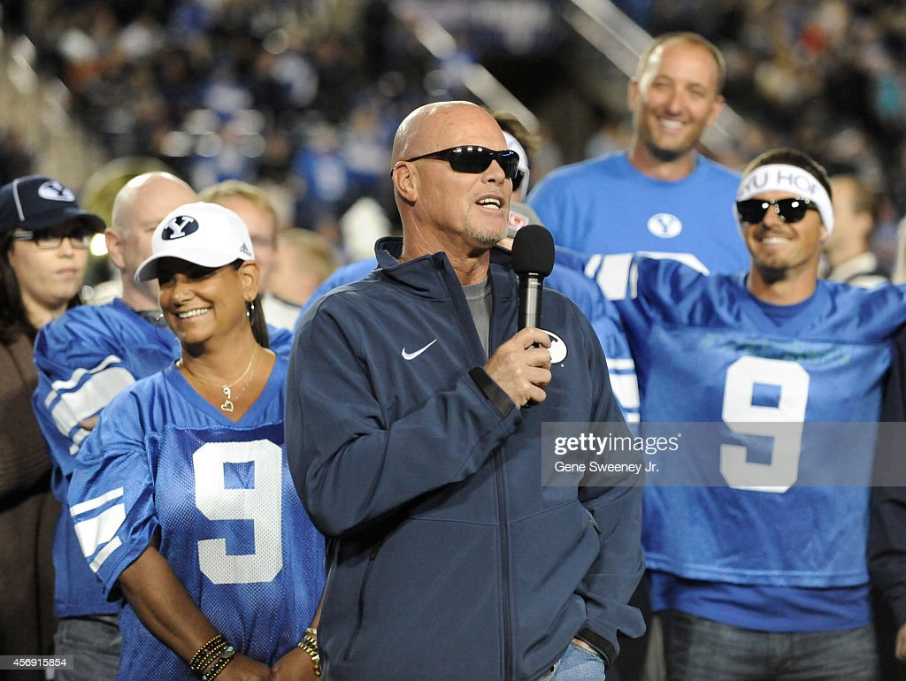<a gi-track='captionPersonalityLinkClicked' href=/galleries/search?phrase=Jim+McMahon+-+American+Football+Player&family=editorial&specificpeople=228299 ng-click='$event.stopPropagation()'>Jim McMahon</a>, former Brigham Young Cougars quarterback, on field at halftime during the game against Utah State Aggies at LaVell Edwards Stadium on October 3, 2014 in Provo, Utah. McMahon was inducted into the school's Hall of Fame and had his jersey number retired.