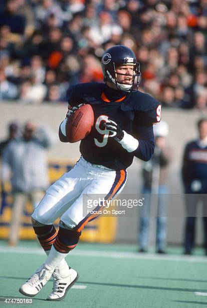 Jim McMahon of the Chicago Bears drops back to pass against the Detroit Lions during an NFL Football game November 22 1987 at Soldier Field in...