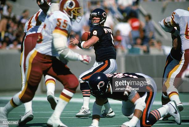Jim McMahon of the Chicago Bears drops back to pass during the game against the Washington Redskins at Soldier Field on September 29 1985 in Chicago...