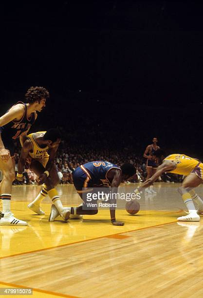 Jim McMillian of the Los Angeles Lakers and Earl Monroe of the New York Knicks go for the lose ball as Happy Hairston of the Lakers blocks out Phil...