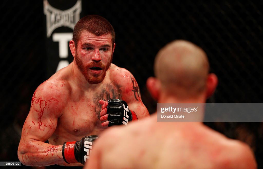 Jim Miller and<a gi-track='captionPersonalityLinkClicked' href=/galleries/search?phrase=Joe+Lauzon&family=editorial&specificpeople=6677563 ng-click='$event.stopPropagation()'>Joe Lauzon</a> face off during their lightweight fight at UFC 155 on December 29, 2012 at MGM Grand Garden Arena in Las Vegas, Nevada.