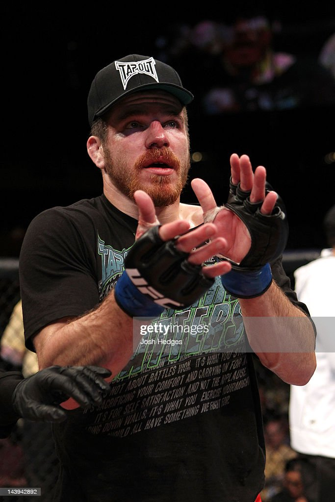 Jim Miller claps after being defeated by Nate Diaz in their Lightweight bout at Izod Center on May 5, 2012 in East Rutherford, New Jersey.
