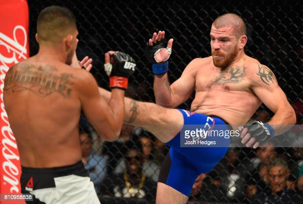 Jim Miller kicks Anthony Pettis in their lightweight bout during the UFC 213 event at TMobile Arena on July 8 2017 in Las Vegas Nevada