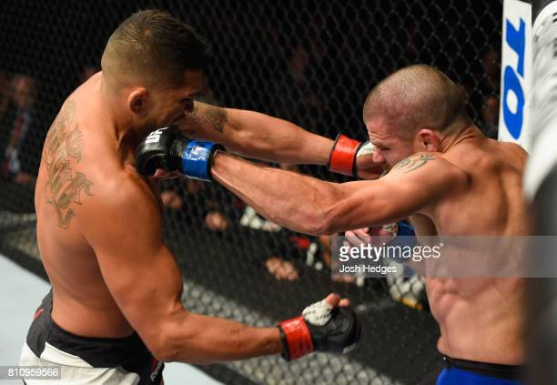 Jim Miller punches Anthony Pettis in their lightweight bout during the UFC 213 event at TMobile Arena on July 8 2017 in Las Vegas Nevada