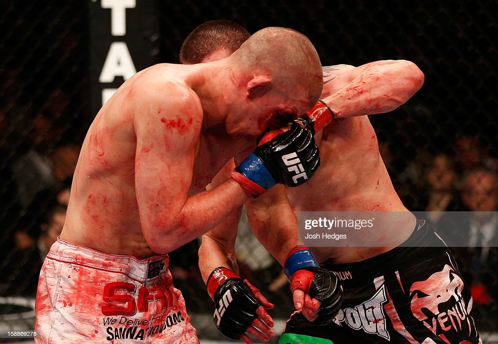 Jim Miller punches Joe Lauzon during their lightweight fight at UFC 155 on December 29, 2012 at MGM Grand Garden Arena in Las Vegas, Nevada.