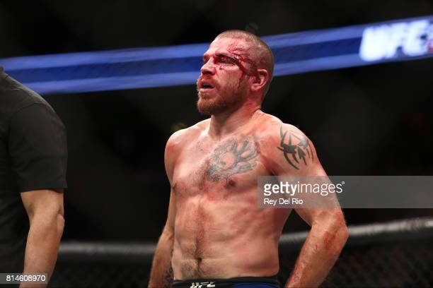 Jim Miller stands in the Octagon between rounds of his bout against Anthony Pettis in their lightweight bout during the UFC 213 event at TMobile...